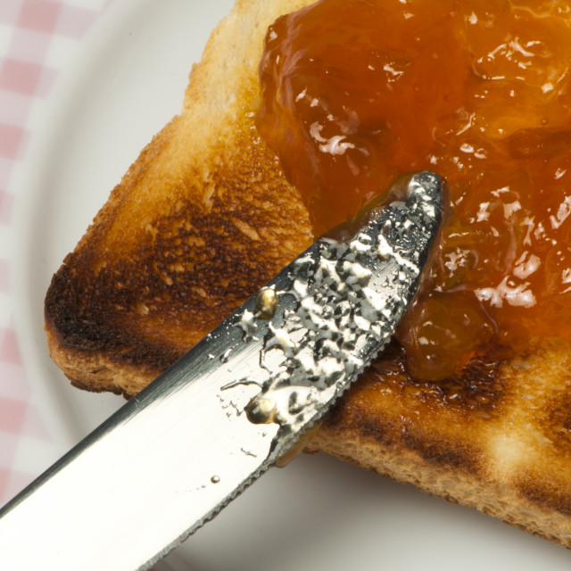 """Spread jam on bread"" stock image"