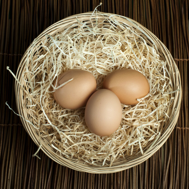 """Raw eggs in a wicker basket"" stock image"