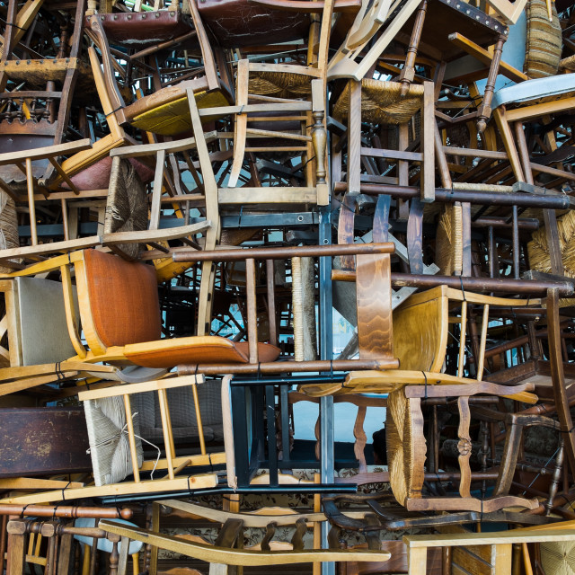 """""""Countless vintage chairs stacked on top"""" stock image"""