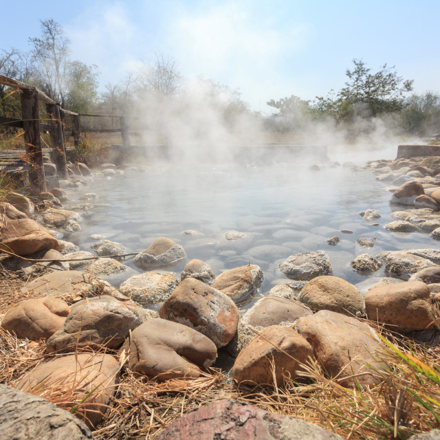 """Natural outdoor hot spring, sky visible"" stock image"