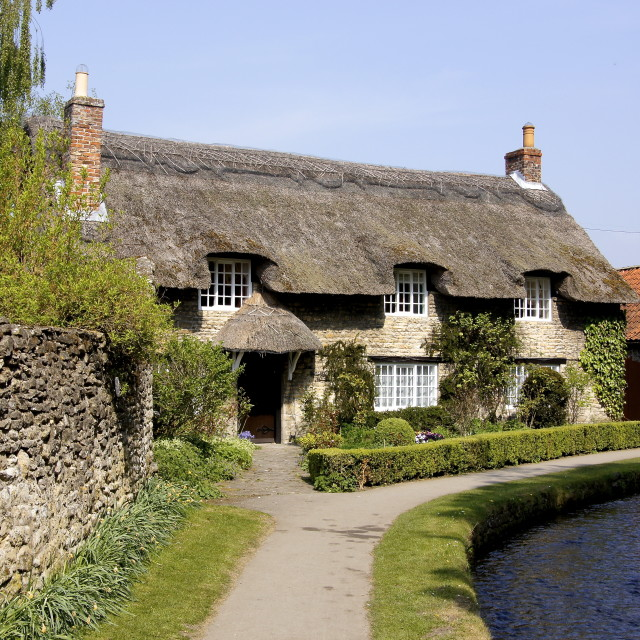 """British Thatched Cottage"" stock image"