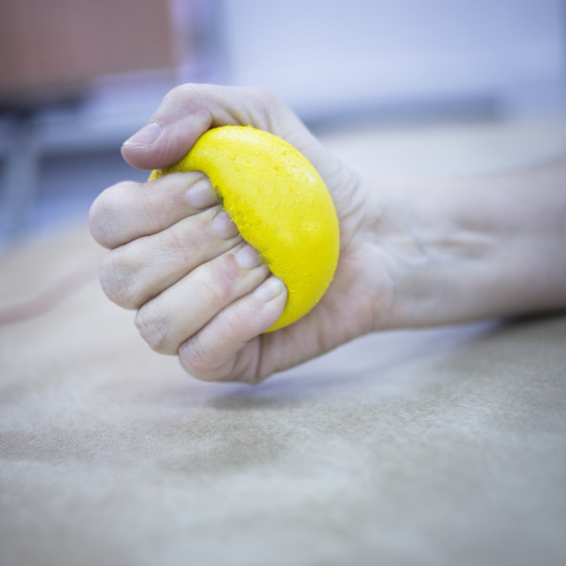 """Patient hand squeezing physiotherapy ball"" stock image"