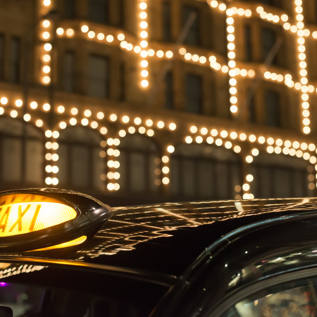 """""""Taxi in London in front of a shopping center"""" stock image"""