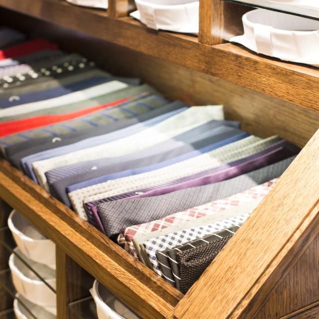 """""""Ties stacked on a shelf in a store"""" stock image"""