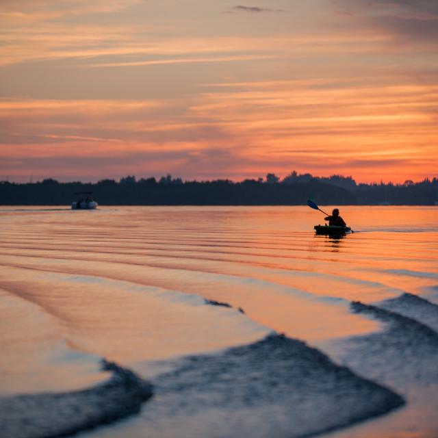 """""""Kayaker at Sunset"""" stock image"""