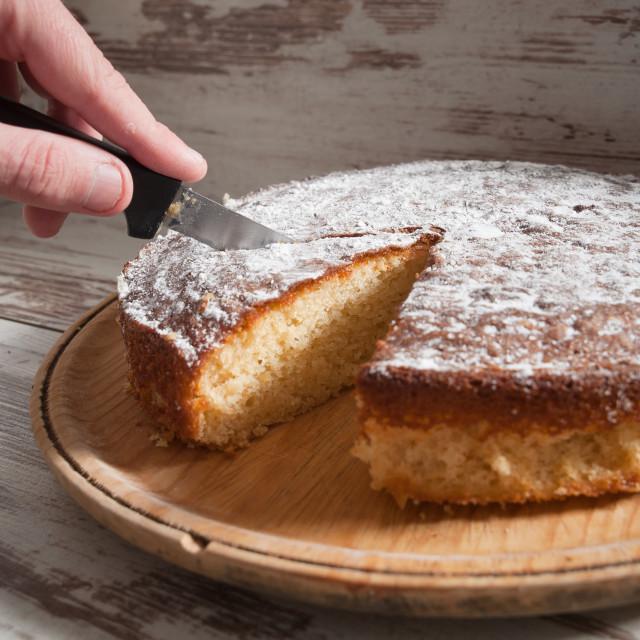 """Cutting a piece of sponge cake"" stock image"