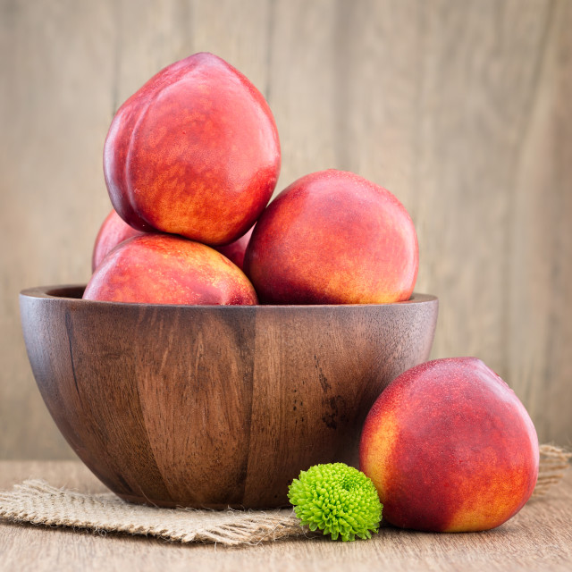 """Juicy fresh peaches on wooden background"" stock image"