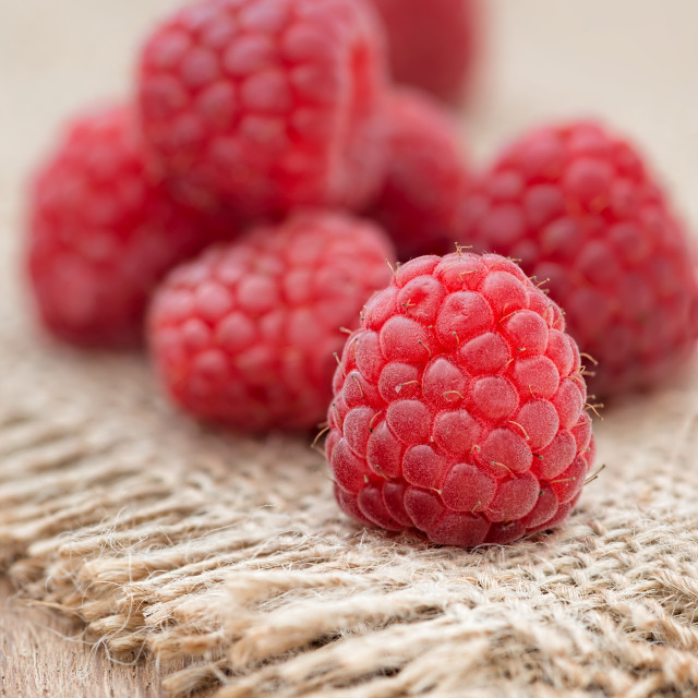 """Fresh raspberry on wooden table"" stock image"