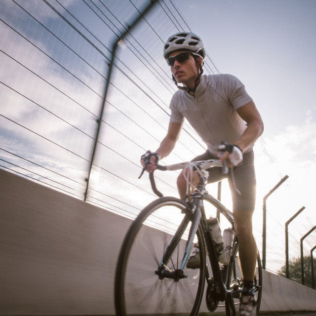 """""""Cyclist in maximum effort in a road outdoors"""" stock image"""