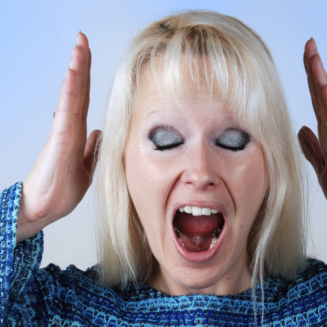 """""""Young blonde woman with a cry"""" stock image"""