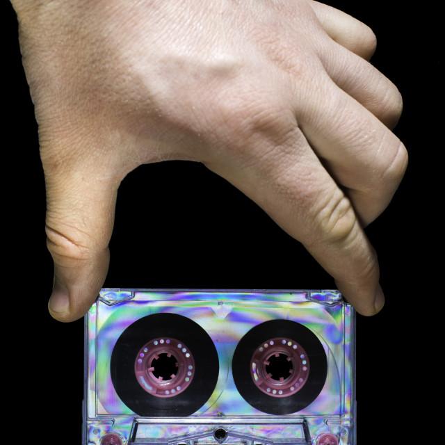 """Hand holding vintage cassette tape"" stock image"