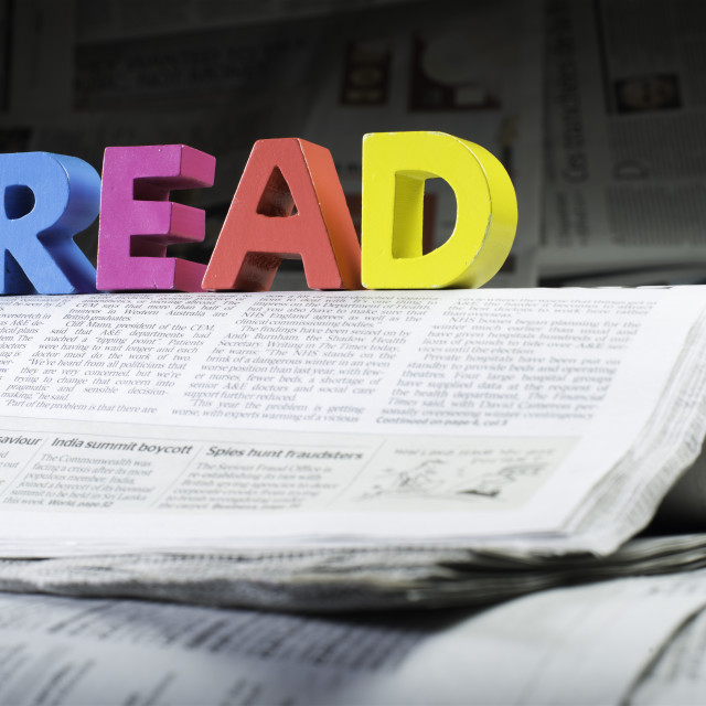 """Word read on newspaper"" stock image"