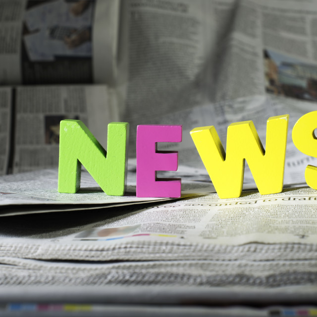 """Word news on newspaper"" stock image"