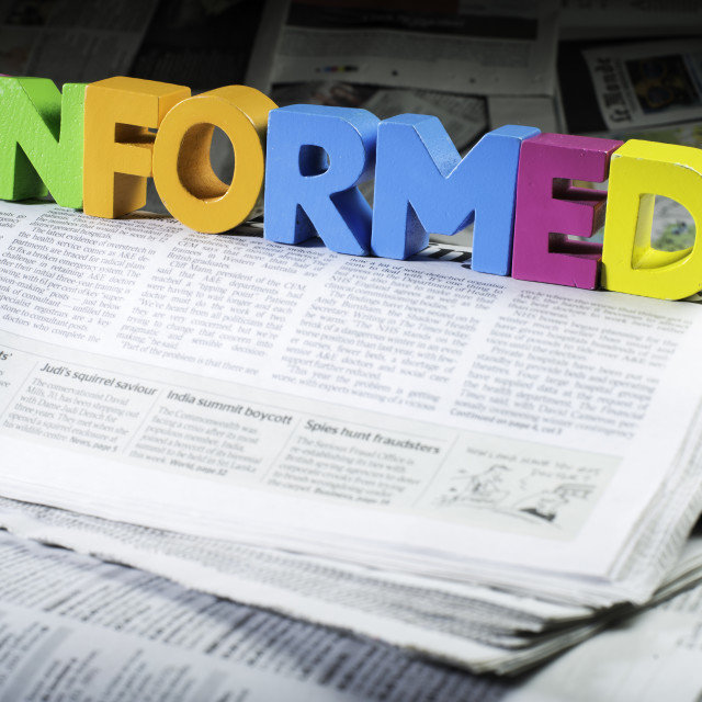 """Word informed on newspaper"" stock image"