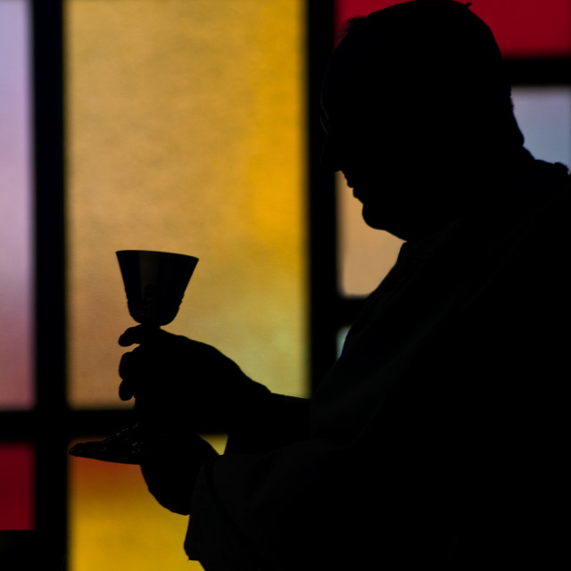 """silhouette of a priest"" stock image"