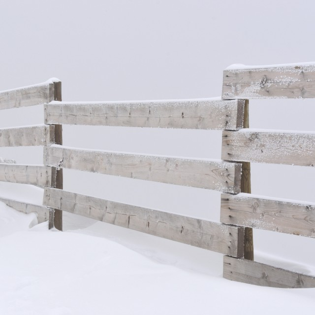"""""""Wooden fence and snow"""" stock image"""