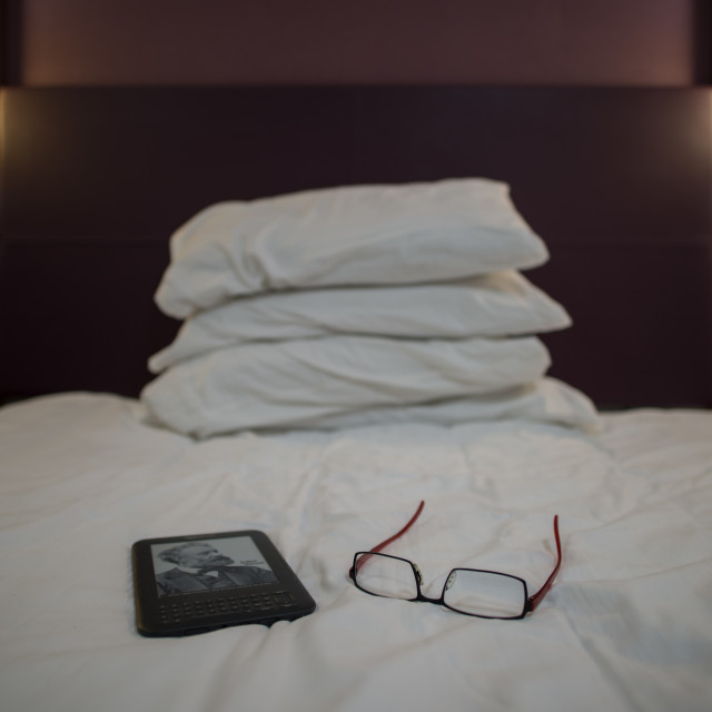 """Reading in bed"" stock image"