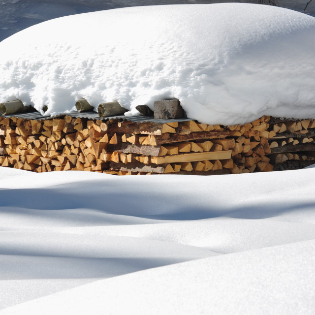 """firewood in snow"" stock image"