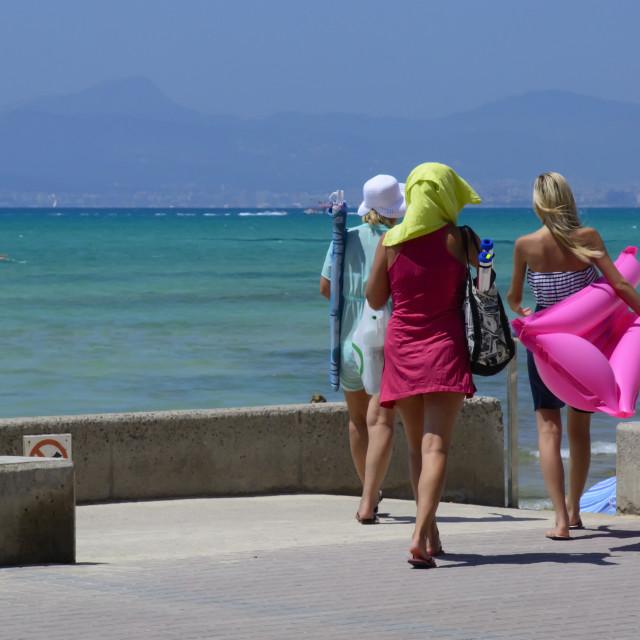 """Three girls go to the beach"" stock image"