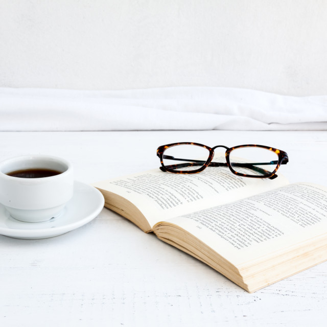 """""""Book with glasses on white wooden table"""" stock image"""