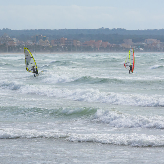 """Two windsurfers ride the waves"" stock image"