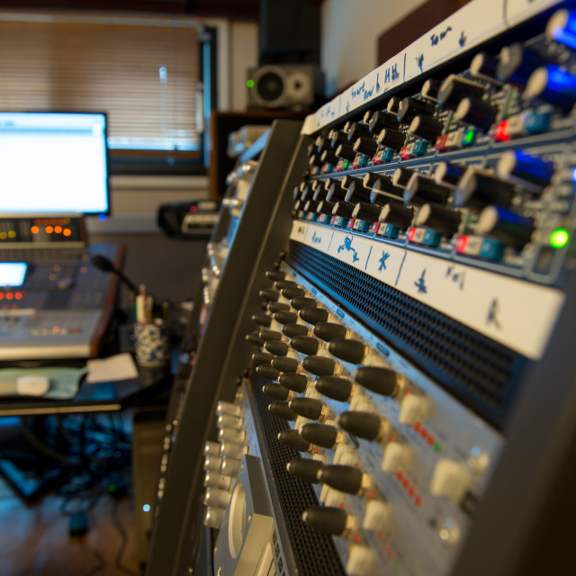 """several mixing consoles in a recording studio"" stock image"