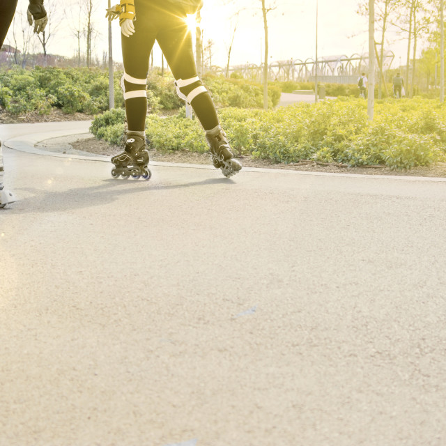 """Girl riding rollerblades"" stock image"