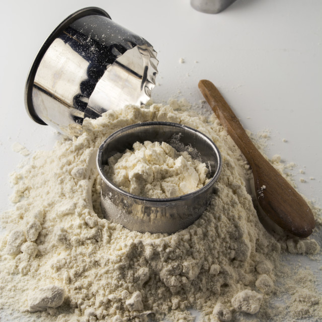 """""""pastry cutters and flour on white wooden board"""" stock image"""