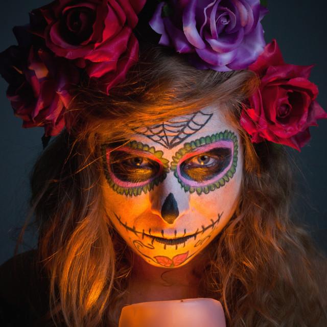 """Halloween witch. Beautiful woman wearing santa muerte mask portr"" stock image"