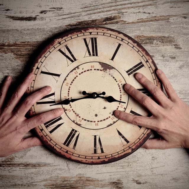 """holding clock"" stock image"