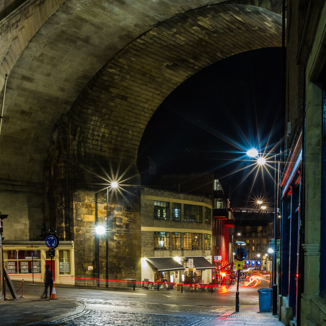 """Under the city Railway arch at night"" stock image"