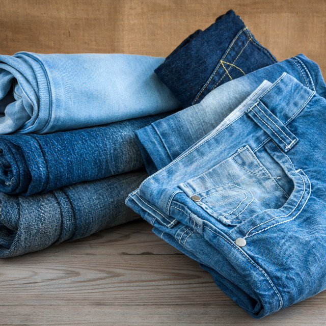 """blue jeans on wooden table"" stock image"