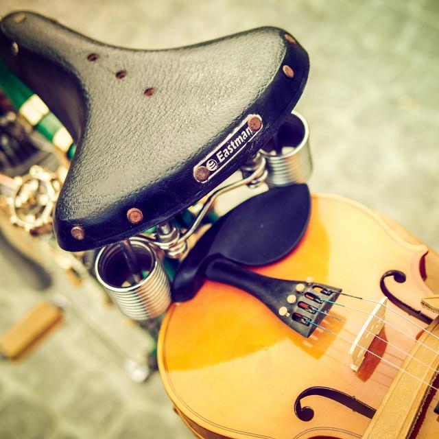 """Violin on a bike"" stock image"