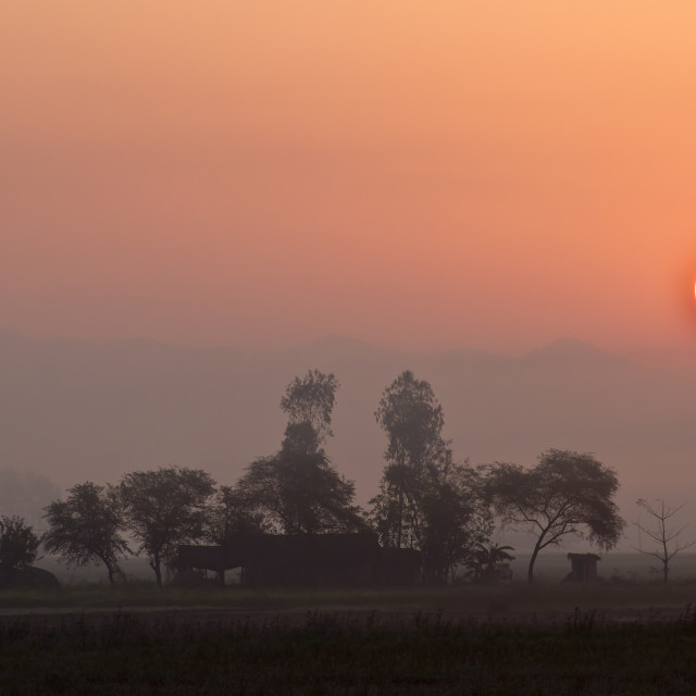 """Sunset in nepali terai"" stock image"