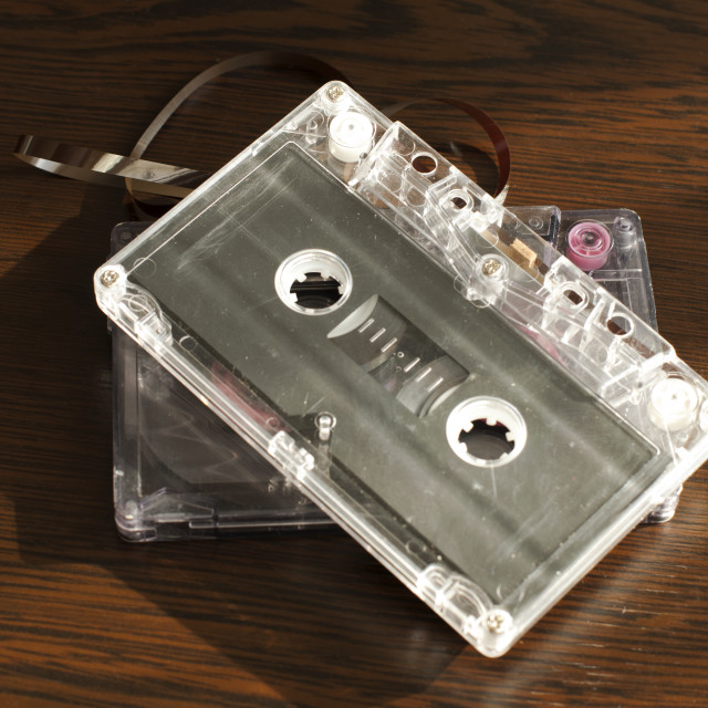 """Audio tape cassettes with subtracted out tape."" stock image"