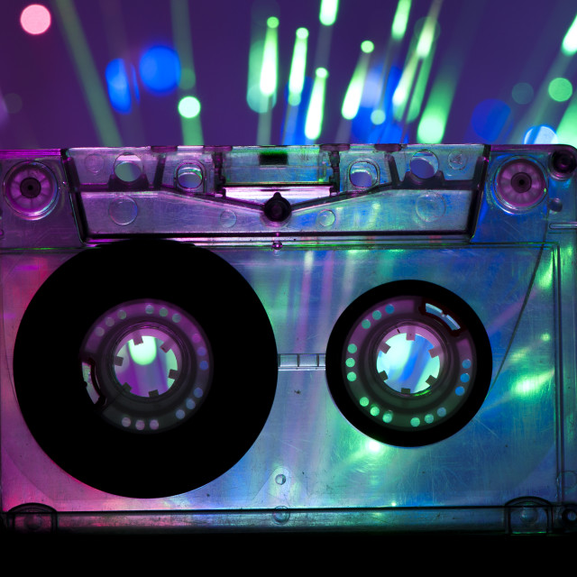 """Transparent Cassette tape and disco light background"" stock image"