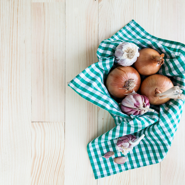 """composition of onions and garlic in basket on wooden table"" stock image"