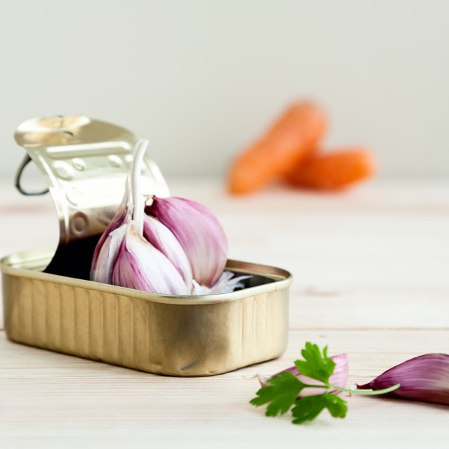 """Garlic and parsley in tin can with carrots"" stock image"