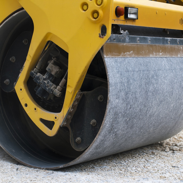 """Roller tamping gravel"" stock image"
