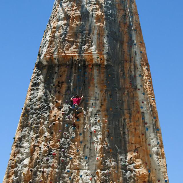 """Boy on a big climbing wall"" stock image"