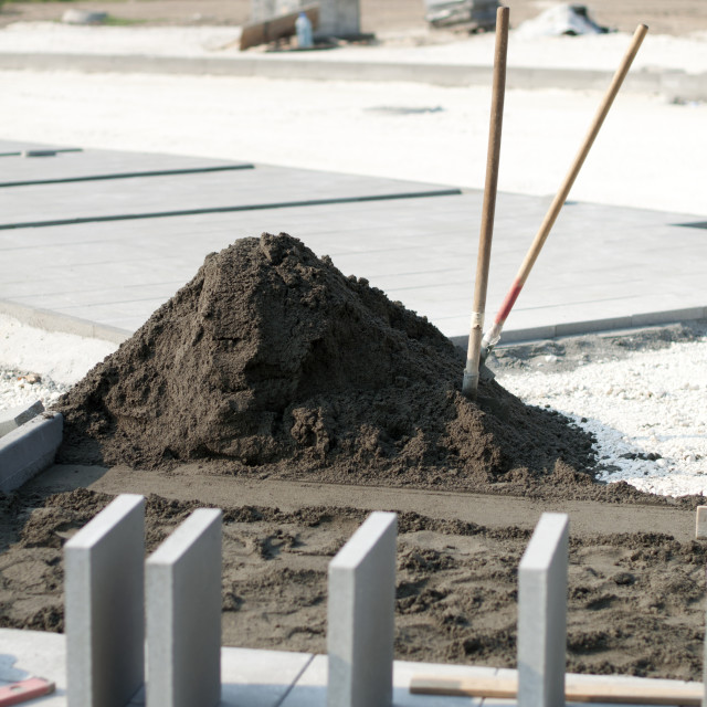 """""""Tiling of pavement and sand pile"""" stock image"""