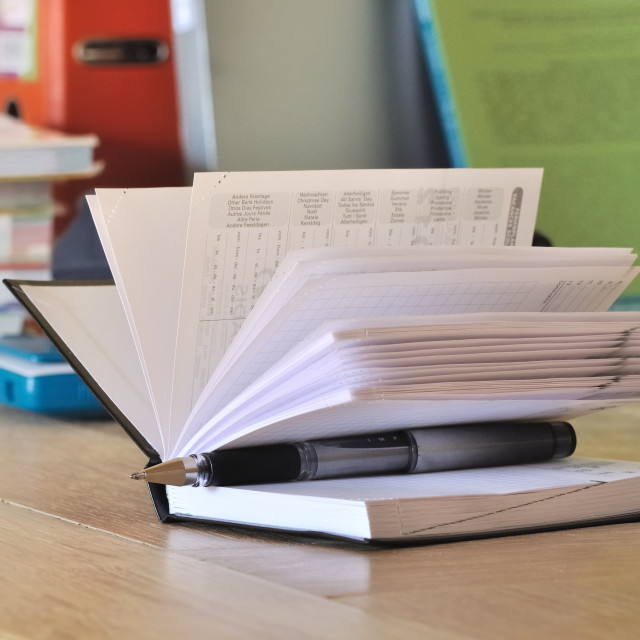 """calendar on the desk of a student"" stock image"