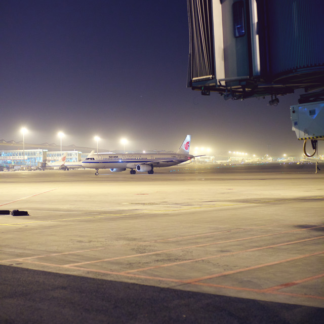 """Beijng Capital Airport at night"" stock image"