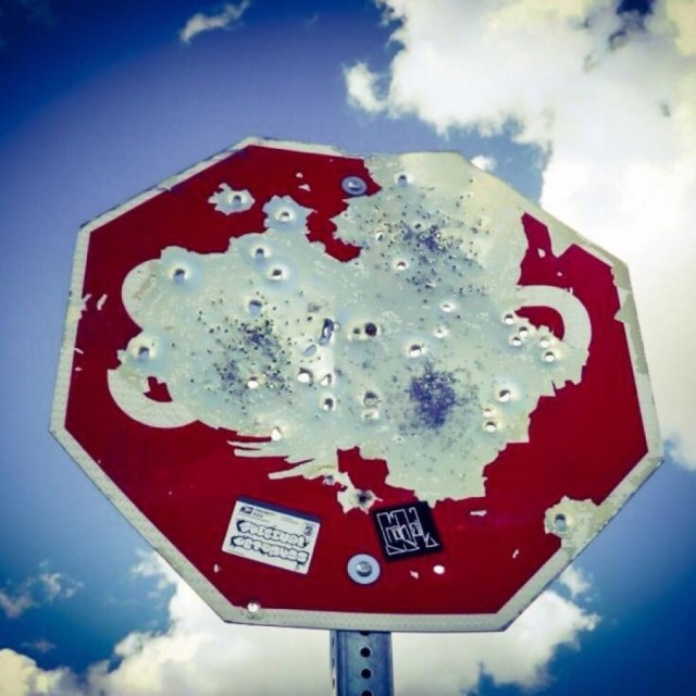 """Bullethole Stop Sign"" stock image"