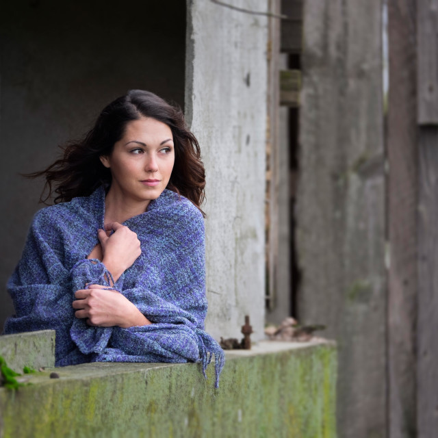 """""""Farm Girl Leaning Out The Window of a Out Building on a Small Farm."""" stock image"""