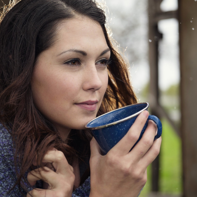 """A Young Woman With Messy Hair Drinking Coffee."" stock image"