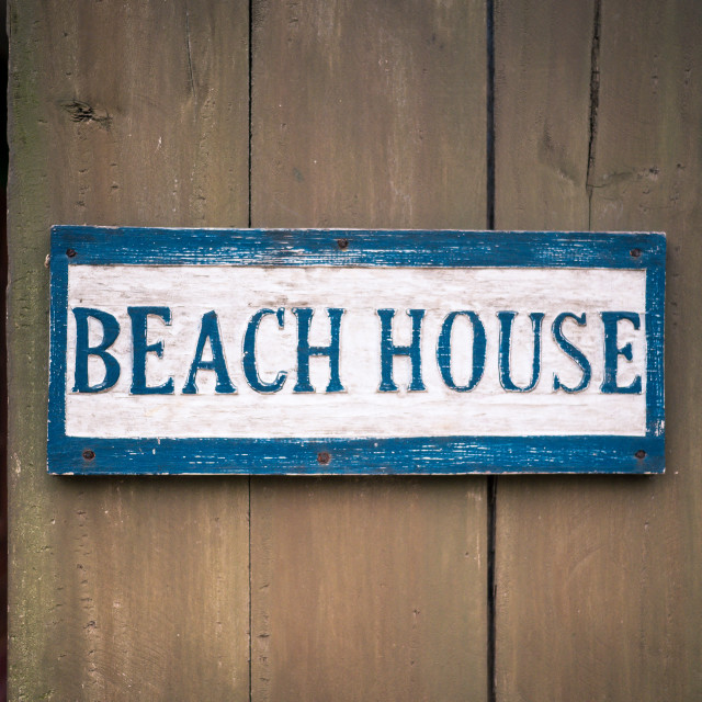 """""""Beach house sign on wooden fence"""" stock image"""
