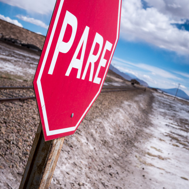 """""""Stop sign (pare) at railway crossing in a desolate landscape"""" stock image"""