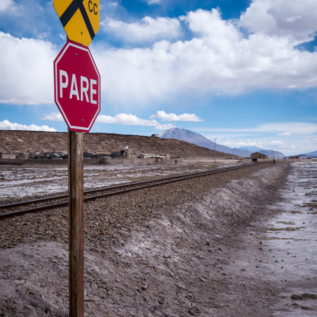 """Stop sign (pare) at railway crossing in a desolate landscape"" stock image"