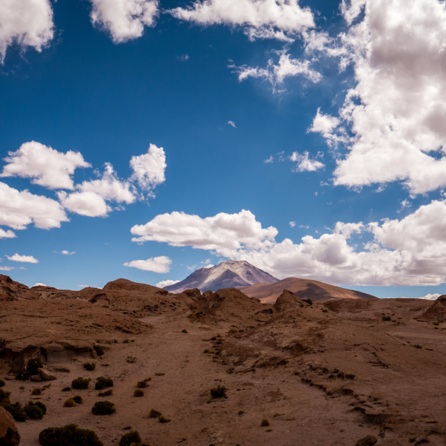"""""""Solitary mountain against dramatic blue sky"""" stock image"""